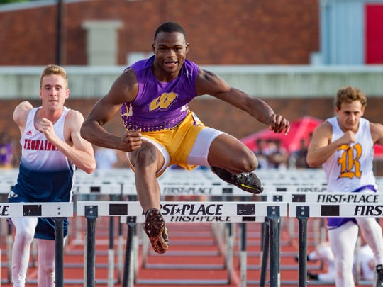 Kayshon Boutte wins the boys  100meter hurdles at the 4-4A district track meet at Northside High School. Wednesday, April 18, 2018.