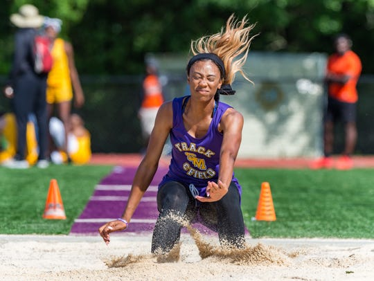 St. Martinville's Jordan Landry wins the girls long jump Thursday at the 5-4A district meet in St. Martinville.