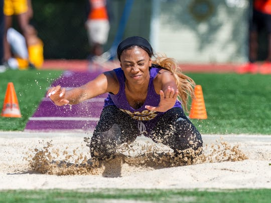 Jordan Landry competes in the girls long jump at the 5-4A District Track Meet at St Martinville High School. Thursday, April 19, 2018.