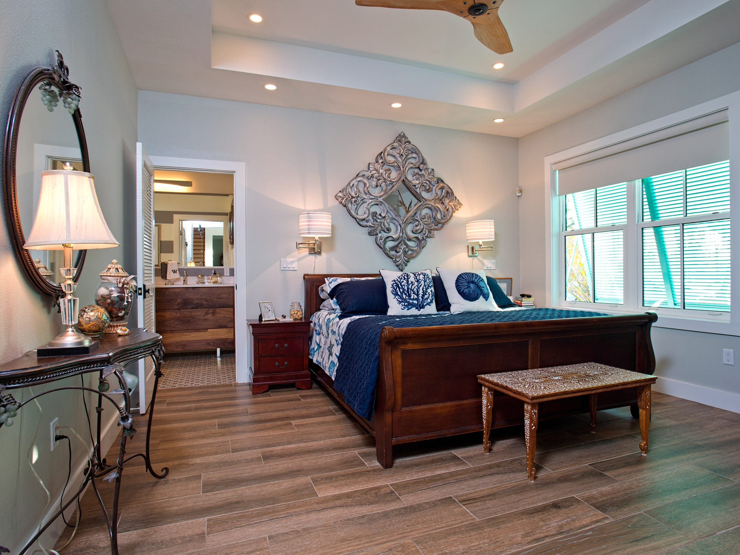 Wood look tile flooring covers the master bedroom which