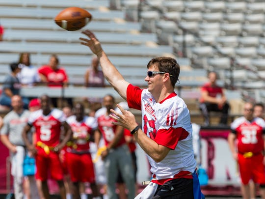 Ex-Cajuns quarterback Jake Delhomme, named Monday to the Carolina Panthers Hall of Honor, throws a pass during UL's 2018 alumni game.