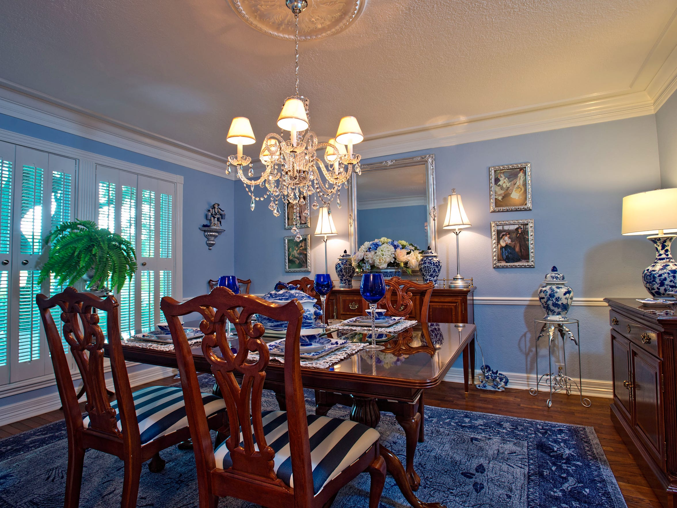 The formal dining area is picture perfect in baby blue