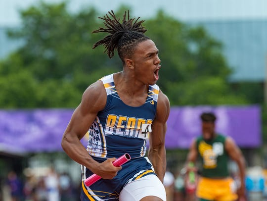 Carencro's Trejun Jones, shown here celebrating the 4x200 relay win at the 4A state track meet, has decided to continue his career with the UL Ragin' Cajuns.