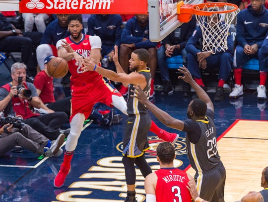 Anthony Davis passes the ball as The New Orleans Pelicans
