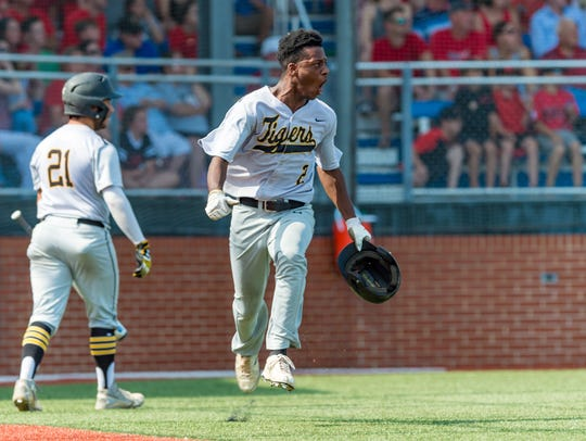 Caleb Washington celebrates after scoring a run as