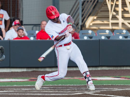 Todd Lott works at the plate for UL against UL Monroe last year.