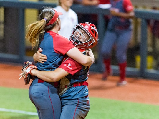 UL catcher Lexi Comeaux and pitcher Summer Ellyson celebrate an NCAA Regional win over Houston last season.