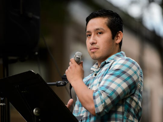 Pablo Pinzon speaks during a demonstration against family separation at the U.S./Mexico border at One City Plaza on Thursday, June 14, 2018.