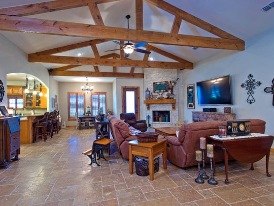 The living space incorporates an open  concept w/ travertine floors throughout, cathedral ceilings w/ Beams, Rock Fireplace