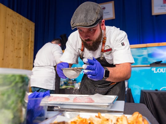 Chef Anthony Felan preparing his dish at the Louisiana Seafood Cookoff in Lafayette, LA. Tuesday, June 19, 2018.