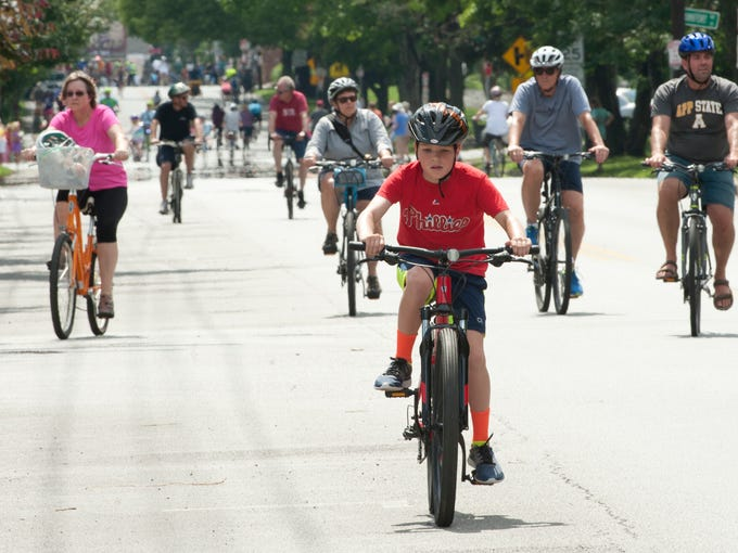 Nate Celello, age 11, of Crescent Hill, bicycles down