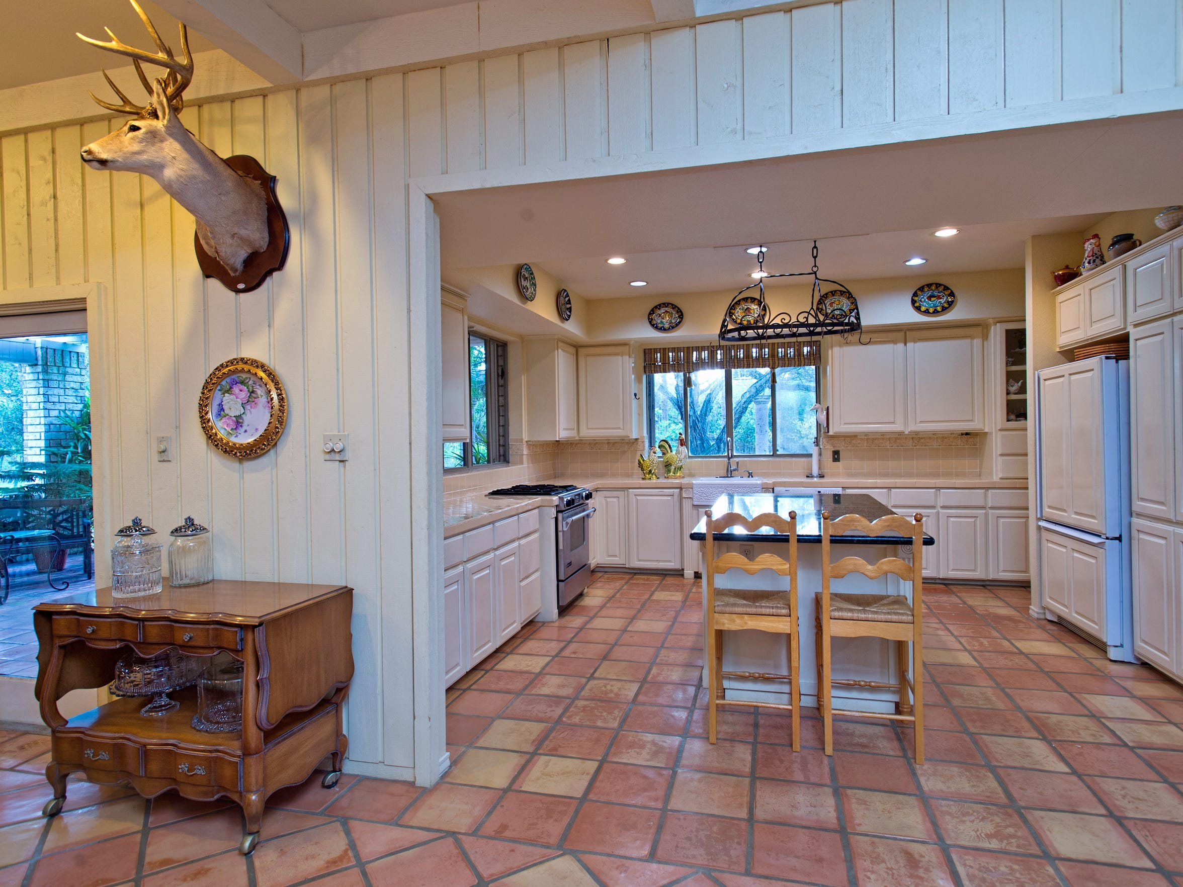 The spacious kitchen, floored in saltillo tile features
