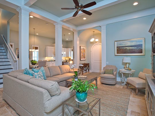 The relaxing and spacious living space is located on the first floor.  The area is bright and airy with shades of light blue and white woodwork throughout the home.