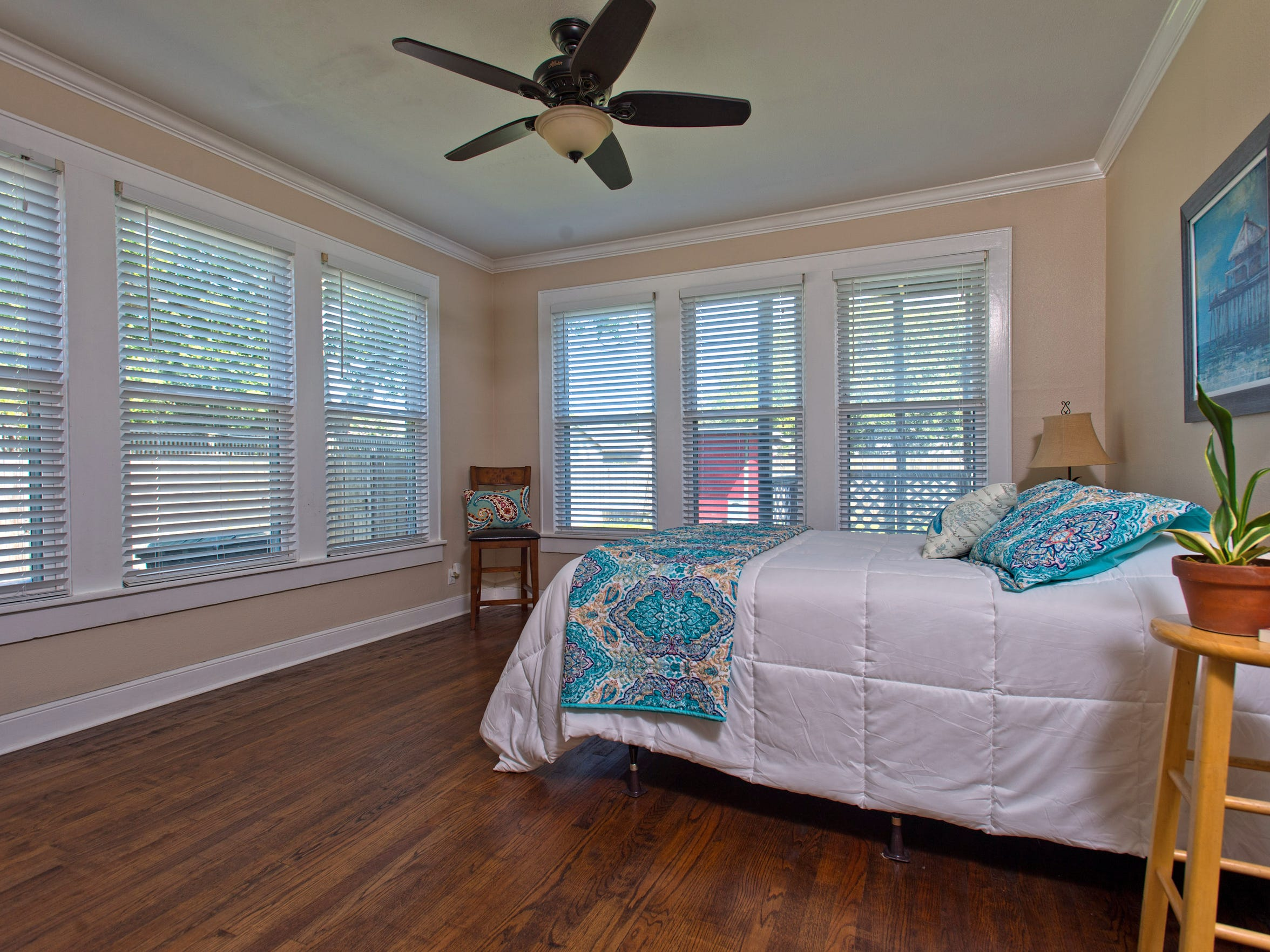 Walls of windows, crown molding and hardwood floors