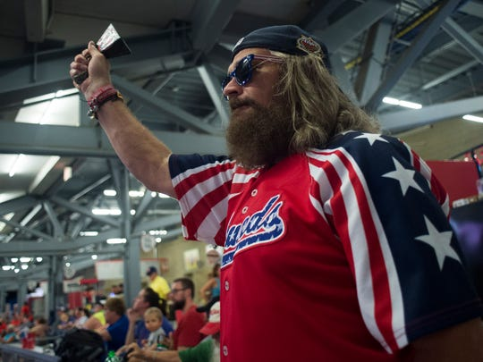 """Tony Slayden, originally of Mt. Juliet and now living in Berry Hill, rings a bell during the Nashville Sounds' 4-1 victory against the Iowa Cubs at First Tennessee Park on Friday, July 6, 2018, in Nashville, Tenn. Slayden is a member of the """"Foul Bells,"""" a group of Sounds fans that often ring cow bells while cheering for the team. He has been a regular attendee of Sounds games since 1987."""