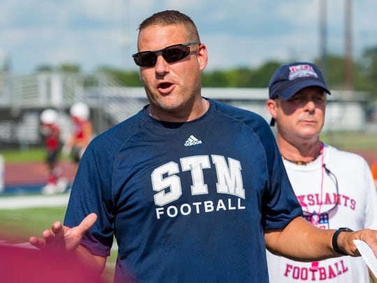 St. Thomas More offensive coordinator Shane Savoie is part of the Cougars' community helping the family of freshman quarterback Walker Howard cope with the recent death of its mother Kathryn.