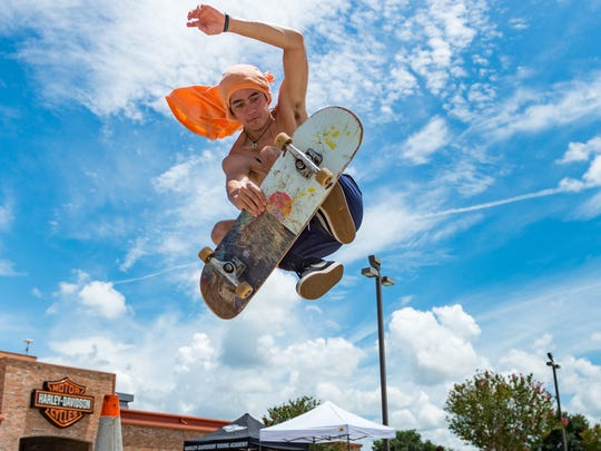 Gavin Goo getting some air at the Skateboard Park Fundraiser at Cajun Harley Davidson. Saturday, July 14, 2018.