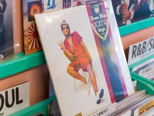 """Bruno Mars' """"24k Magic"""" album from 2016 is among the more recent vinyl releases at Lagniappe Records."""