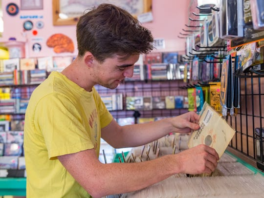 Kirkland Middleton, a drummer with the Grammy-winning Lost Bayou Ramblers band, looks through the 45s at Lagniappe Records.