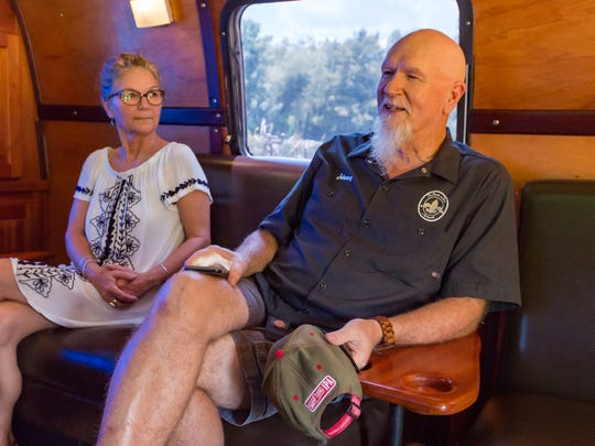 Tomi and Johnny Johnson sitting in Airstream trailer known as the mobile cigar lounge. Thursday, Aug. 2, 2018.