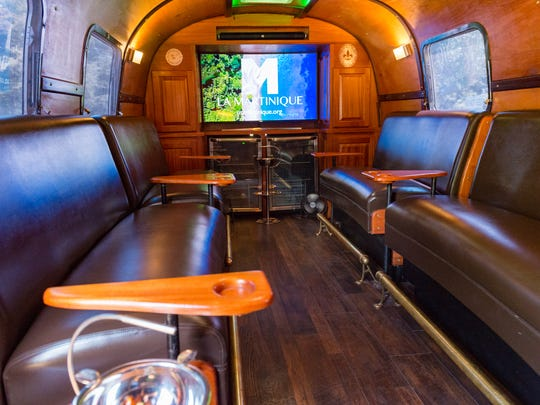 Johnny Johnson converted an Airstream trailer into a mobile cigar lounge that he brings to festivals and private events. Thursday, Aug. 2, 2018.