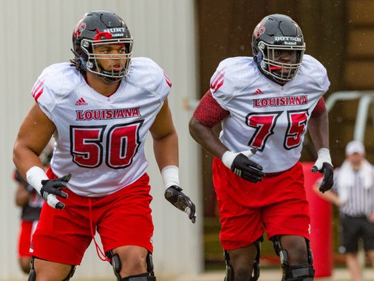 Robert Hunt (50) and Kevin Dotson (75) will be playing together on the right side of UL's offensive line this season.
