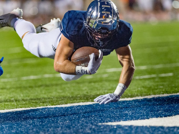 William Cryer dives into the endzone to score as STM