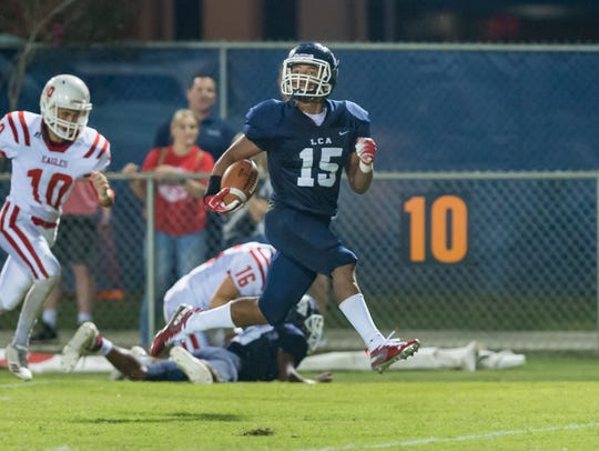 Sage Ryan breaks a tackle and runs the ball in for a touchdown as Lafayette Christian Academy takes on Central Catholic on Sept. 28.