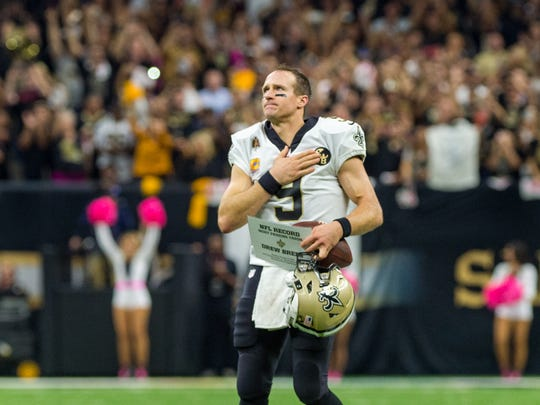 Drew Brees thanks the fans after breaking the NFL record for passing yards as The New Orleans Saints take on The Washington Redskins during Monday Night Football at the Mercedes-Benz Superdome. Monday, Oct. 8, 2018.