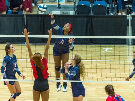 Kiera Washington hitting as LCA competes in the semi-final round of the LHSAA State Volleyball Championships.  Friday, Nov. 9, 2018.