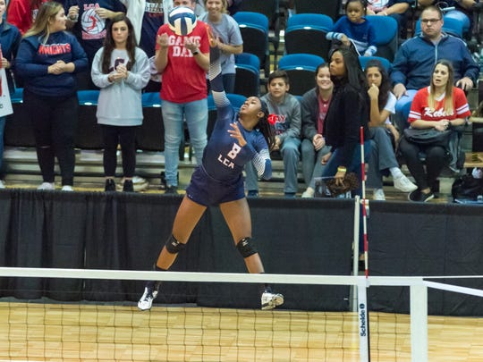 Kourie Calloway serves for LCA in last season's 2018 state semifinal game.
