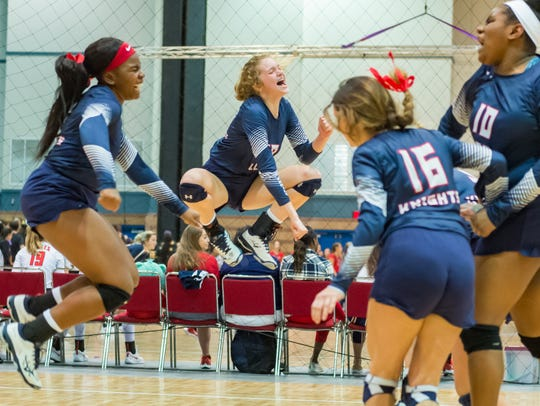 LCA celebrates a big point during the Lady Knights' Division V state semifinals loss to Country Day on Friday at the Pontchartrain Center in Kenner.