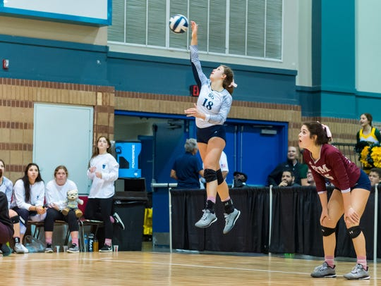 Meredyth Howard serves for St. Thomas More during the semifinal round of the LHSAA state volleyball championships Friday.