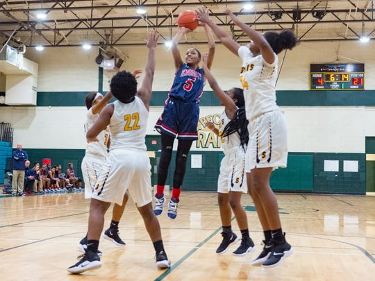 Tamera Johnson shoots the ball as LCA girls basketball take on Scotlandville in tournament at Acadiana High. Thursday, Nov. 29, 2018.