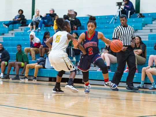 Zoe Wiltz drives the ball as LCA girls basketball take
