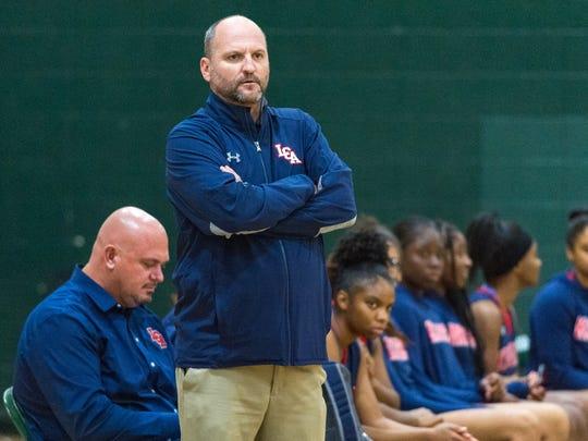 Head Coach Devin Lantier as LCA girls basketball take
