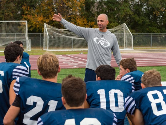 St. Thomas More wide receivers coach Lance Strother has played and coached the Cougars.