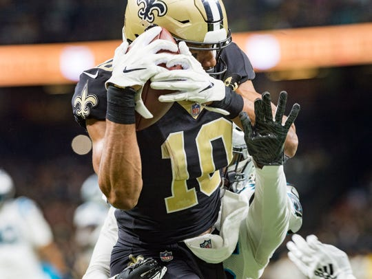 Saints receiver Tre'Quan Smith makes a catch in the