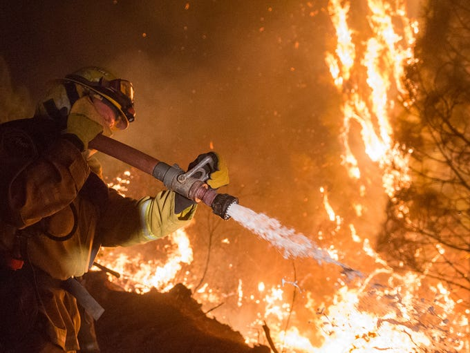 Firefighters working to control the Camp Fire north