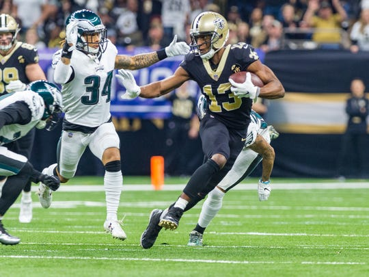 Saints receiver Michael Thomas runs the ball Sunday during the NFC divisional playoff game against the Philadelphia Eagles in New Orleans.