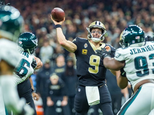 Saints quarterback Drew Brees throws a pass Sunday during the NFC divisional playoff game against the Philadelphia Eagles in New Orleans.