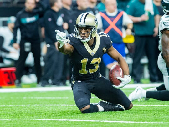 Saints receiver Michael Thomas makes a catch for a first down Sunday during the NFC divisional playoff game against the Philadelphia Eagles in New Orleans.