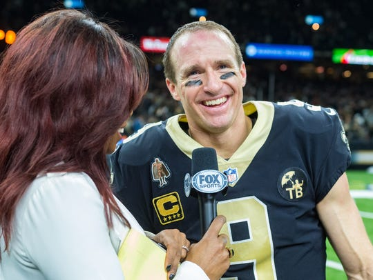 Saints quarterback Drew Brees speaking with media following