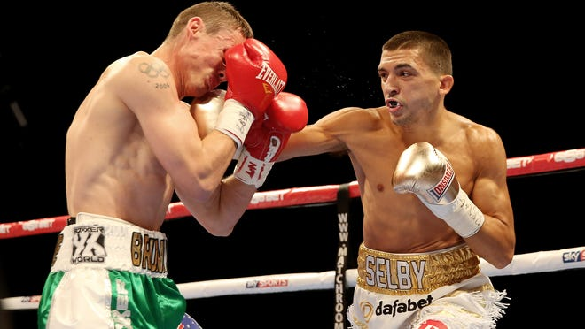 Lee Selby ithrows a right hand against Joel Brunker during their Final Eliminator IBF Featherweight World Championship bout at O2 Arena in October 2014 in London. (Photo: Scott Heavey/Getty Images)