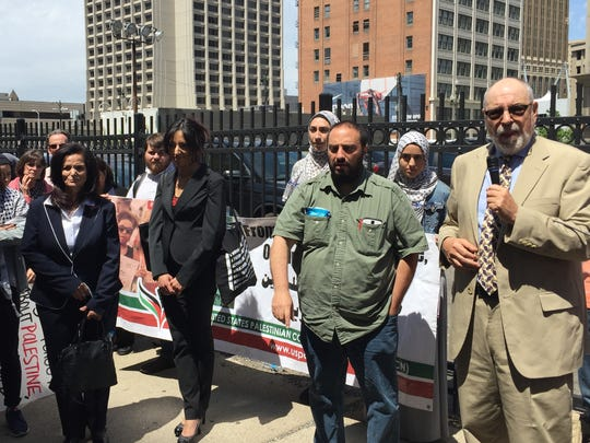 Michael Deutsch, attorney, speaks after court hearing for Rasmieh Odeh in federal court in Detroit on June 13. To his right is Hatem Abudayyeh of the Arab American Action Network, Palestinian activist Huwaida Arraf, and Rasmieh Odeh.