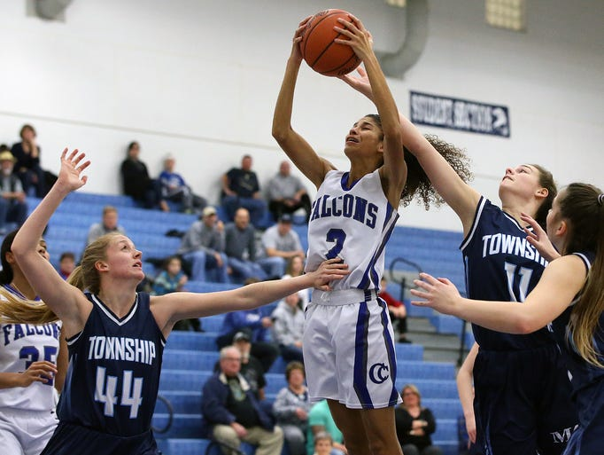 Cedar Crest's Ariel Jones (2) grabs a rebound against