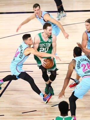 Miami Heat guard Tyler Herro (14) defends against Boston Celtics forward Gordon Hayward (20) in the first half of an NBA basketball game Tuesday, Aug. 4, 2020, in Lake Buena Vista, Fla.