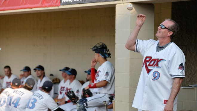 Twins legend Gene Larkin wears an honorary jersey Friday night as he tosses the ball on the sidelines of the St. Cloud Rox home opener before throwing out the first pitch.