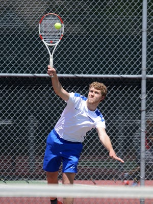 Paul Eide of Sioux Falls Christian serves as he and Thomas Blankespoor play Nicholas Lust and Chase Thurness in a flight 1 doubles match Thursday at the state tennis tournament at McKennan Park, May 21, 2015.