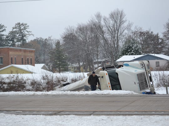 A tanker truck rests on its side in a ditch along southbound Highway 141 in Oconto County on Monday afternoon. The truck had collided with a car about 30 minutes earlier.